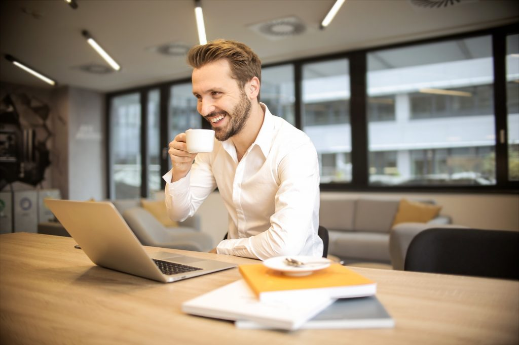 Man in front of computer doing Online Life Coaching